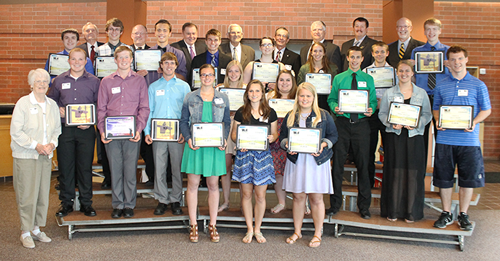 A group of students display scholarships given to them by Wright-Hennepin Electric