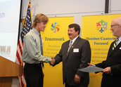 Wright-Hennepin Electric board members present students with their scholarships