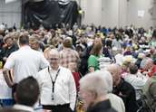A group of people enjoy a meal at Wright-Hennepin's annual meeting
