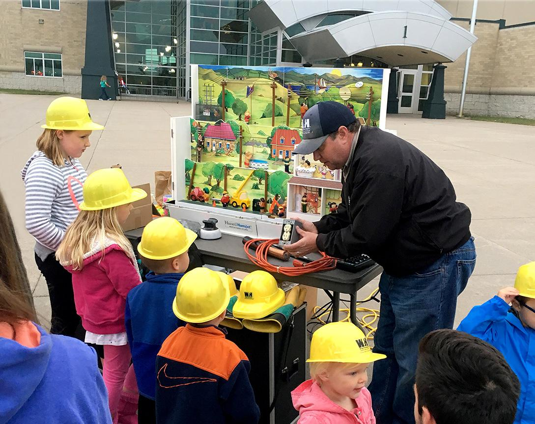 WH employee teaching about electric safety in the community