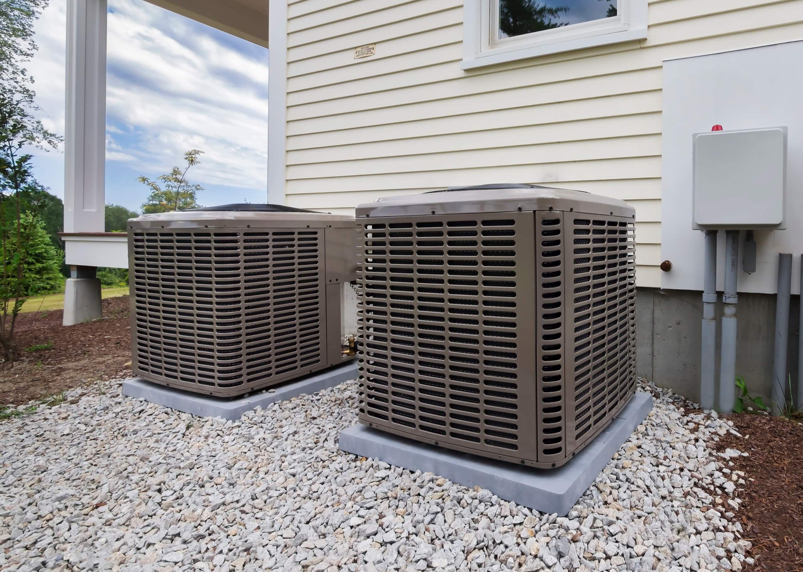 View on two air conditioners beside a home