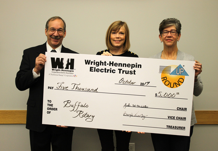 Wright-Hennepin delivering a check for Operation Round Up
