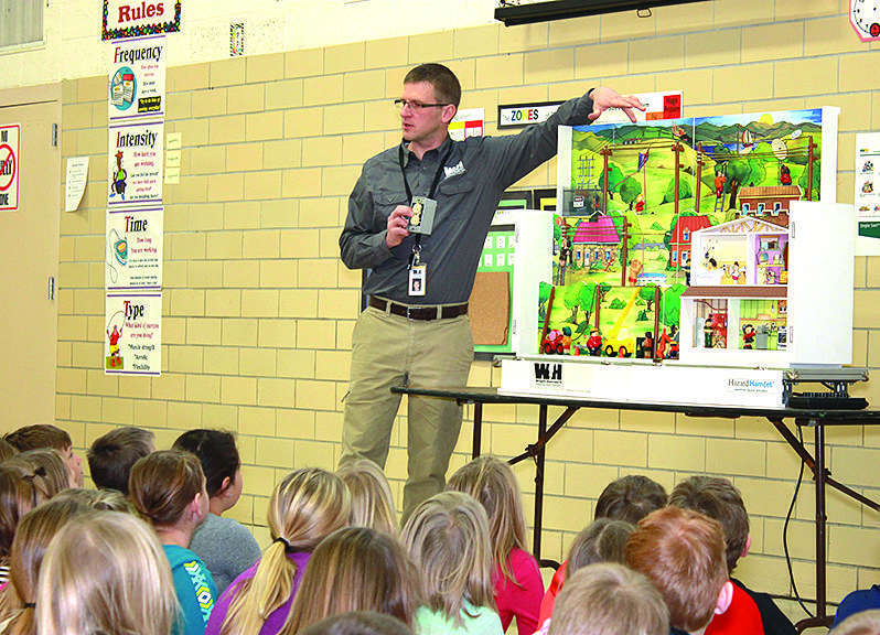 Wright-Hennepin provides a live demonstration for children