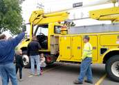 Kids ride on Wright-Hennepin Electric's aerial bucket truck