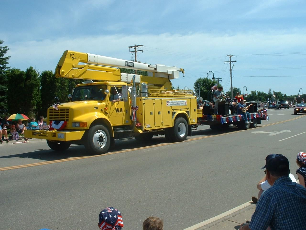 Wright-Hennepin Electric's truck hauls a float through a local parade