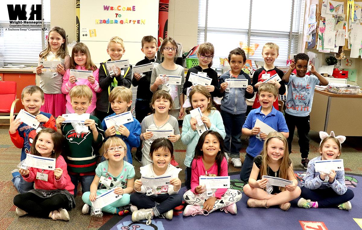 A classroom of students from Cedar Island Elementary School in Maple Grove hold up their new night lights.