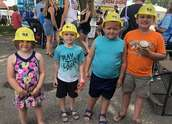 Children pose wearing Wright-Hennepin hard hats